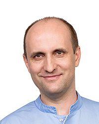 Маликов Александр Иванович- стоматолог-терапевт стоматологической клиники ЕМС. Лечение корневых каналов.